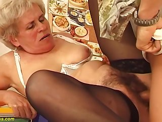Hairy Hungarian granny is sucking a immensely younger guys dick and getting fucked hard, in mention