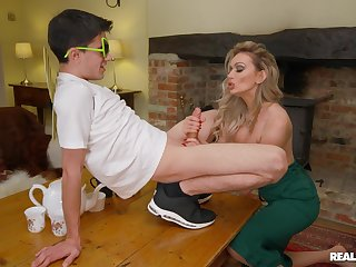 Sophisticated blonde MILF Amber Jayne enlightens a younger man