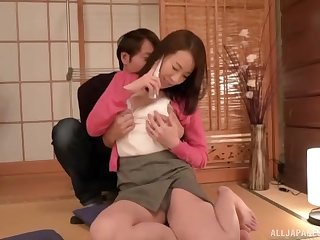 Clothed Japanese MILF undresses for a big chunk of young cock