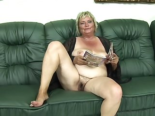 Blonde cougar Zsuzsanna gets her tight cunt smashed on the couch