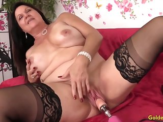 Titillating and sweltering mature woman enjoys their pussies drilled wide of shacking up machines